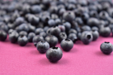 Blueberries stock images. Blueberries on a purple background. Healthy summer fruit
