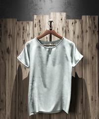 Mock-up t-shirt on dark wood background