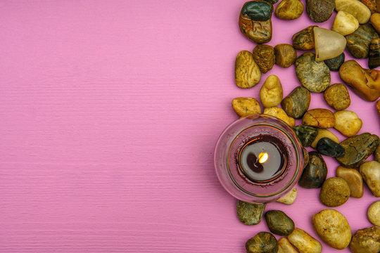 Beautiful burning candle on wooden background
