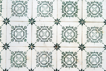 Typical old Lisbon tiles, detail of a classic ceramic tiles .