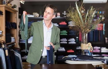 Adult man choosing new tie