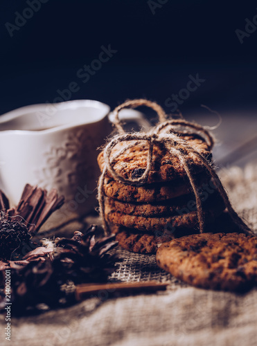 Chocolate Cookies On Rustic Wooden Table And Sackcloth