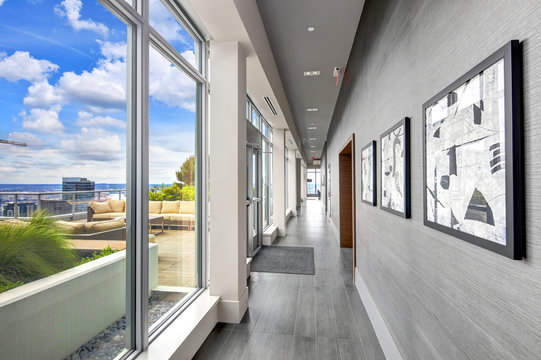 Condo hall interior with luxurious deck overlooking Seattle.