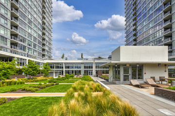 Luxury apartment building features open-air park.