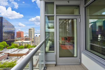 Condo balcony interior with view of Seattle.