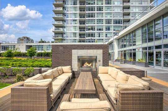 Luxury apartment building with open-air park.