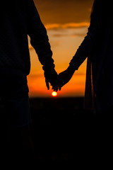 Together.Couple.Hold hands.Photo at sunset.Hand.Silhouette photo.Lover