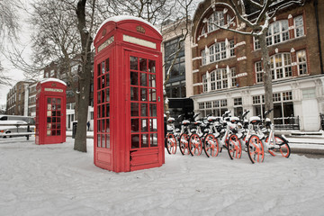 Red Telephone box in a snowy London Street