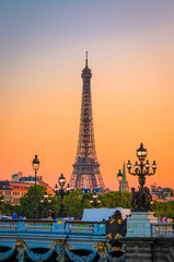 Sunset view of  Eiffel Tower and Alexander III Bridge in Paris, France.