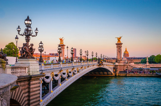 Beautiful sunset view on Pont Alexandre III and Les Invalides in Paris, France