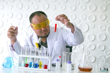 Scientists experiment in laboratory science.