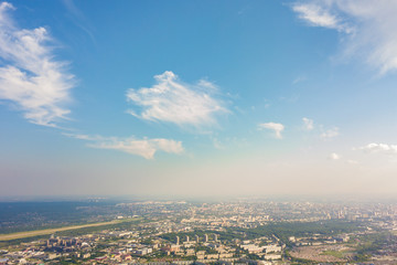 Photographing from a quadrocopter to a large  city,  highways, a green forest and a large field on a warm, sunny summer day