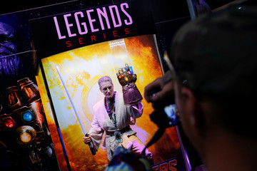 Attendee Travis Pottier poses for a pictures during preview night before the opening of pop culture convention Comic Con in San Diego
