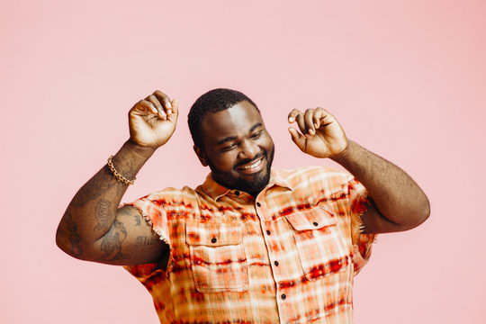 Plus size man with arms up, feeling great