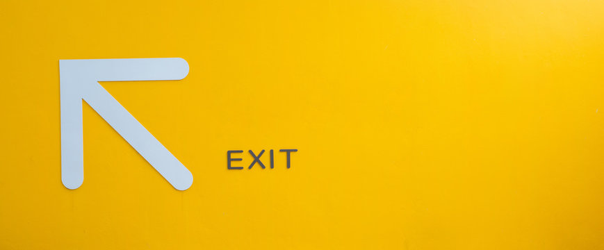 Yellow exit sign, empty space.