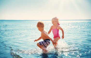 Boy and girl playing on the beach