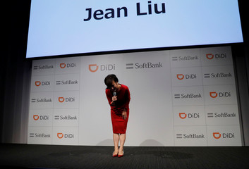 President of Didi Chuxing Jean Liu bows on the stage during a news conference about their Japanese taxi-hailing joint venture in Tokyo