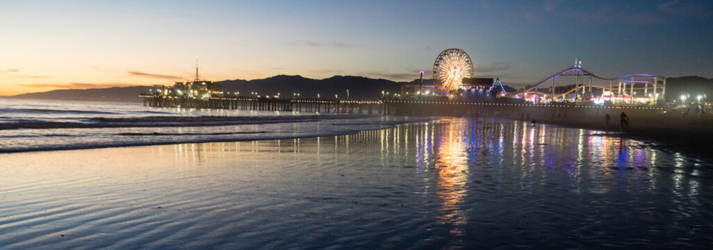 People Frolic in the Water on the Beach in Santa Monica, CA