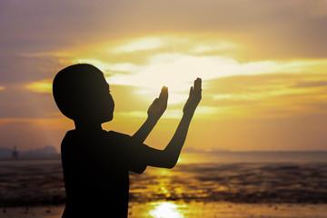 silhouette boy praying