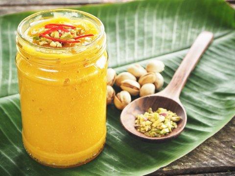 Mango lassi on banana leaves Indian drink