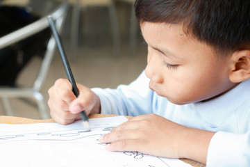 boy is drawing cartoon