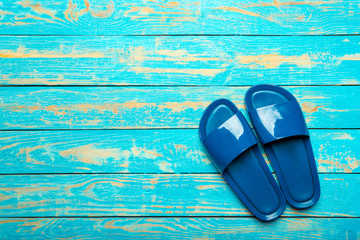 flip-flops on color wooden background