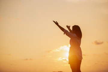 Women raised both hands up pray for blessings to God hands lift worship