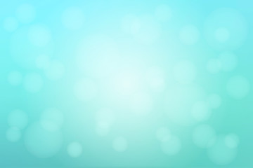 Pale turquoise green blurred background with bokeh lights