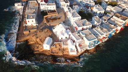 Aerial photo from iconic Paraportiani church in little Venice at sunset, old port of Mykonos island, Cyclades, Greece
