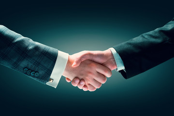 Businessmen handshake closeup