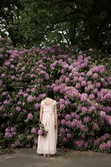 Girl in front of rhododendrons