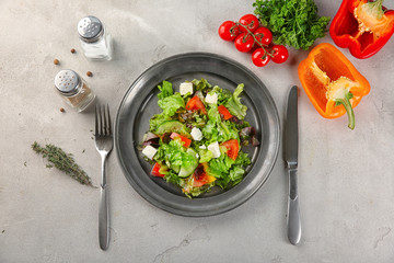 Plate with fresh vegetable salad on table. Diet food