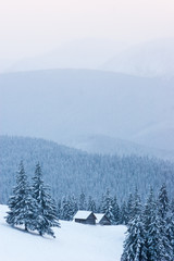 Fototapete - Winter landscape with wooden houses in the mountains