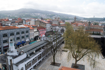 View across rooftops and squares in the modern part of Guimaraes, Portugal