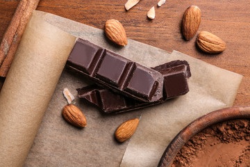 Delicious chocolate with almonds on table