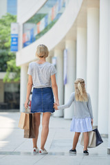 Shopping mother and daughter