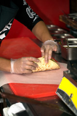 Real kitchen of fast food restaurant and the chef who cooking a doner kebab