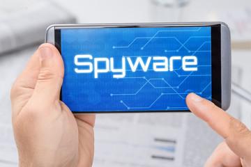 Smartphone mit dem Text Spyware auf dem Display - fototapety na wymiar