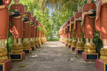 Buddhist monks in a straight line in a buddhist temple in cambodia
