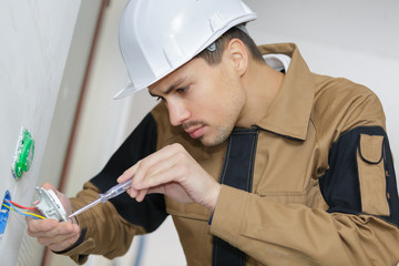 electrician mending the plug