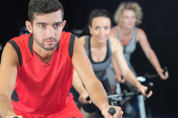 group in the gym on the stationary bikes