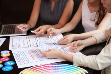 Designers sketching interface plan