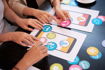 Designers discussing icons