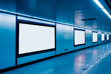 modern hallway of airport or subway station with blank billboards on wall