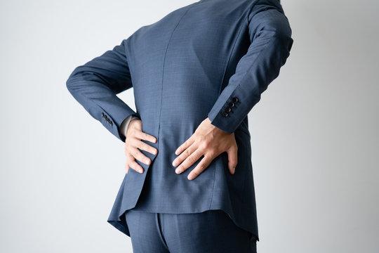 ビジネスマン、腰痛、腰、デスクワーク