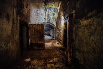 Dark and creepy corridor of old abandoned forgotten Soviet underground bunker