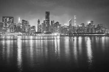Black and white picture of Manhattan at night, New York City, USA.