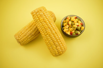 Boiled corn stock images. Corn salad in a bowl. Corn on the cob stock images. Yellow maize stock images. Two corn cobs on a yellow background