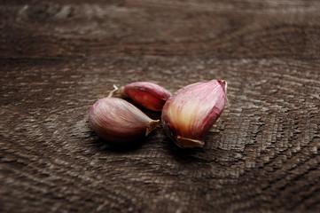 young garlic on a wooden table