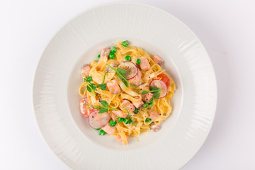 Front and top view isolated - Tagliatelle with salmon and tomatoes.